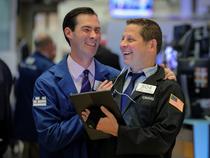 Wall Street jumps after bumper jobs data, upbeat tone on trade