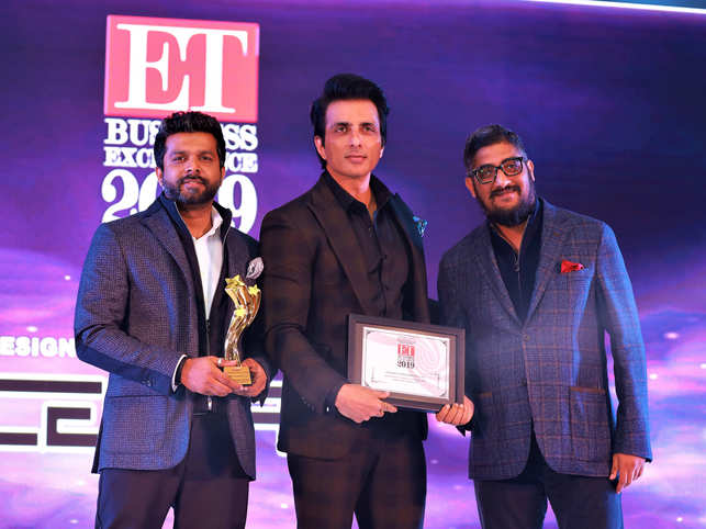 ​Ashish Abraham, founder and MD, CentriX Projects, and Prajwal MN, director of design, CentriX Projects, with actor Sonu Sood​.