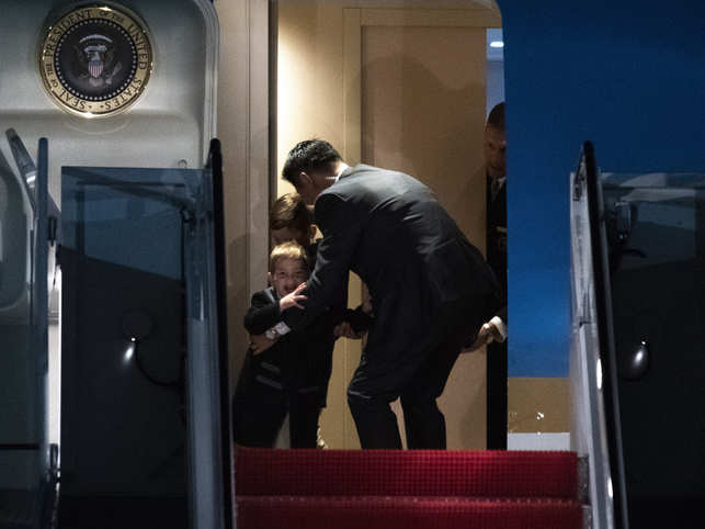A Secret Service agent stops Theodore James Kushner and his brother Joseph Frederick Kushner, sons of Ivanka Trump, from exiting AF1.