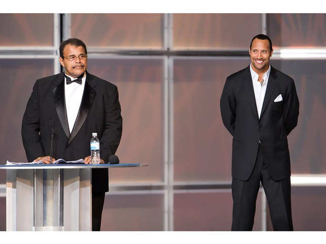 Dwayne 'The Rock' Johnson (R) inducted his father Rocky Johnson into the WWE Hall of Fame in 2008.