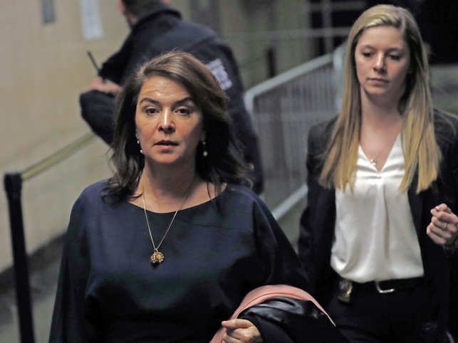 Actress Annabella Sciorra, left, leaves Manhattan Criminal Court after appearing at Harvey Weinstein's rape and sexual assault trial.