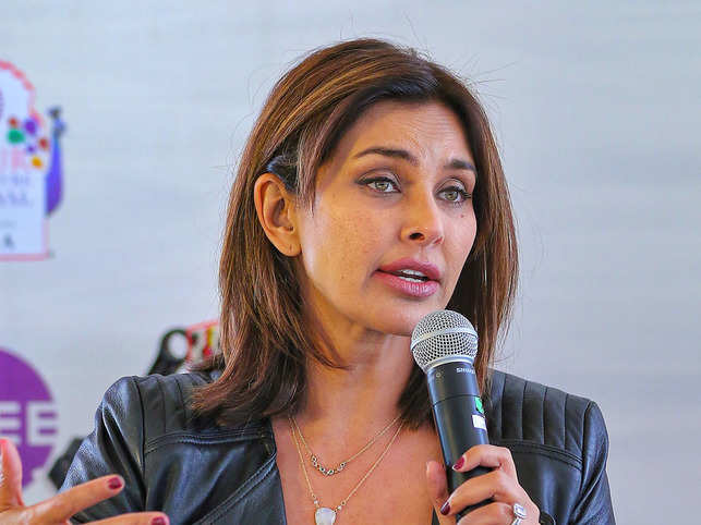 ​Talking about her book 'Close to the Bone', which chronicles her battle with cancer, Lisa Ray said she liked to describe it not as a memoir, but as a 'travelogue with a soul'. ​