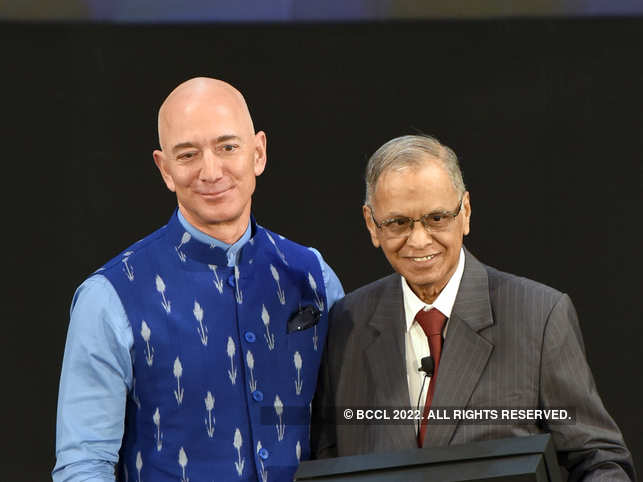 ​Amazon CEO ​Jeff Bezos (R) greeted Infosys Co-Founder​ ​Narayan Murthy during Amazon's annual event, Smbhav,​ in New Delhi​ on January 15, 2020.