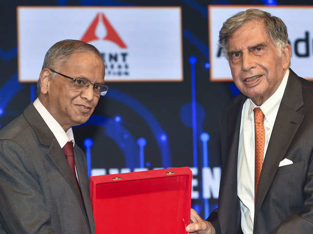 Indian IT industrialist and co-founder of Infosys, N R Narayan Murthy (L) confers the TIE Con Mumbai 2020 lifetime achievement award to Indian industrialist Ratan Tata in Mumbai.