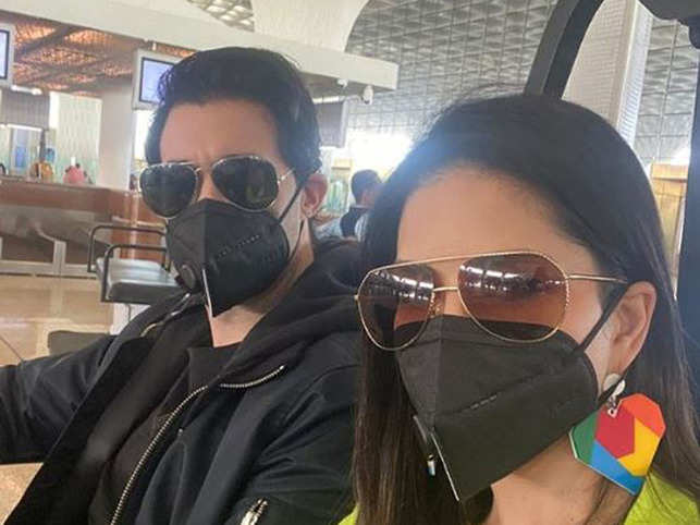 In the photograph, Sunny can be seen with her husband Daniel Weber, both donning a black-coloured mask.