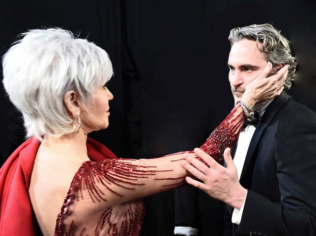 Jane Fonda ​comforts ​Joaquin Phoenix after he receives his Oscar for Best Actor at the 92nd Academy Awards in Hollywood.