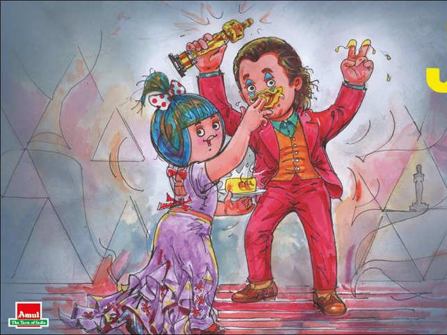 The artwork shows the Amul girl, feeding Amul butter to Joaquin Phoenix who is dressed as Joker.