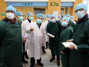Experts from China and the World Health Organization (WHO) joint team wearing face masks visit the Wuhan Tongji Hospital in Wuhan Reuters
