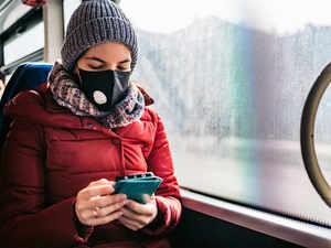 virus mask phone getty