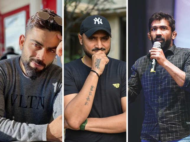 Virat Kohli (L), Harbhajan Singh (C) and Yogeshwar Dutt (R) were few of the many sports stars who sent out tweets to support the self curfew.