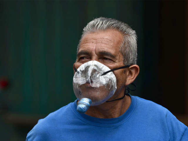 A mask made with recyclable bottles, cans - The unusual masks people are  using to beat COVID-19 | The Economic Times
