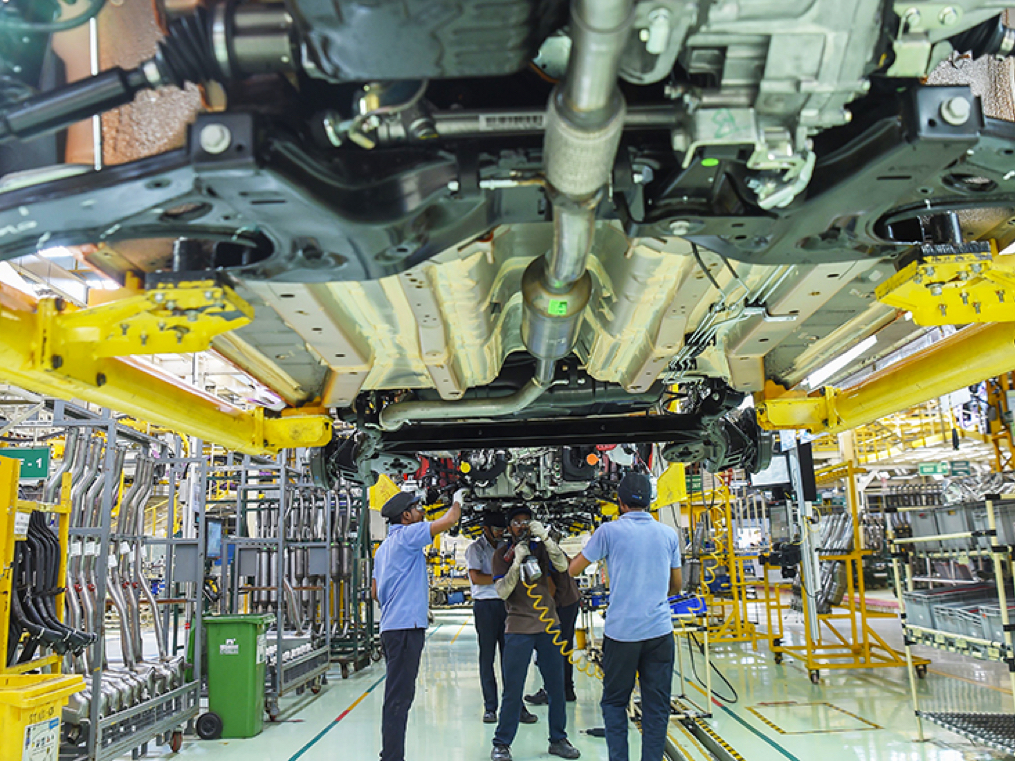 Robots alone can't make cars. Work from home is not really a long-term option for automakers.