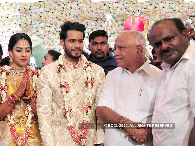 Karnataka CM BS Yeddyurappa (2nd right) blessed the newly-wed couple Nikhil Kumaraswamy (2nd left) and Revathi (left), and greeted former CM HD Kumaraswamy (right) in a private ceremony in Bengaluru.