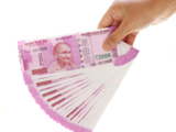 Rupee opens 7 paise up at 75.57 against dollar