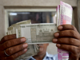 Rupee inches 21 paise higher buoyed by gains in equities