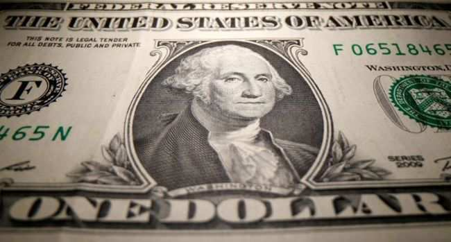 Dollar off 2-year low as investors await US stimulus talks
