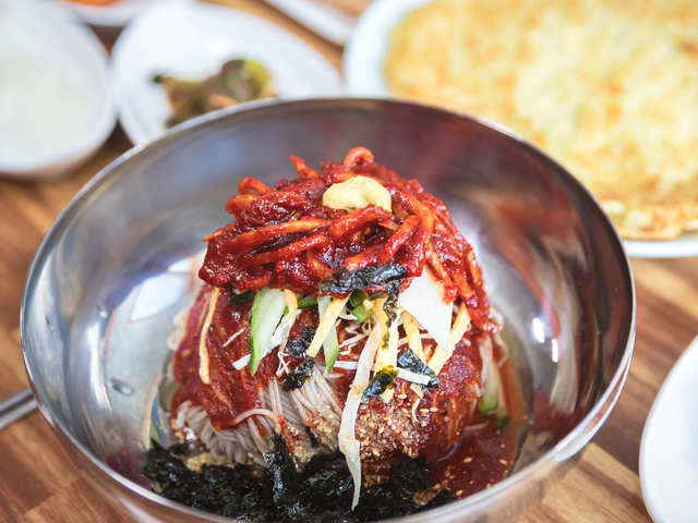 Don't let the pandemic dampen your wanderlust, indulge in South Korea's tangy-spicy Bibim Guksu