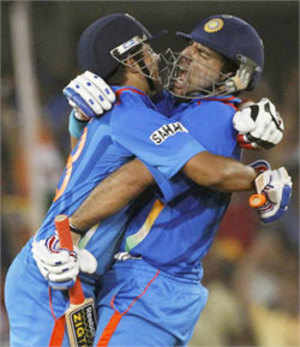 Suresh Raina (L) hugs teammate Yuvraj Singh after they defeated Australia in their Cricket World Cup 2011 quarter-final match in Ahmedabad on March 24, 2011.(REUTERS)