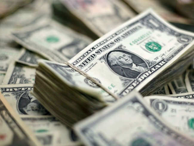 Dollar consolidates gains at 2-month highs on economic concerns