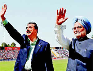 Prime Minister Manmohan Singh with his Pakistani counterpart Yusuf Raza Gilani before the start of the World Cup cricket semi-final match in Mohali on Wednesday.
