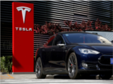 Tesla crosses $800 bn in market cap for first time