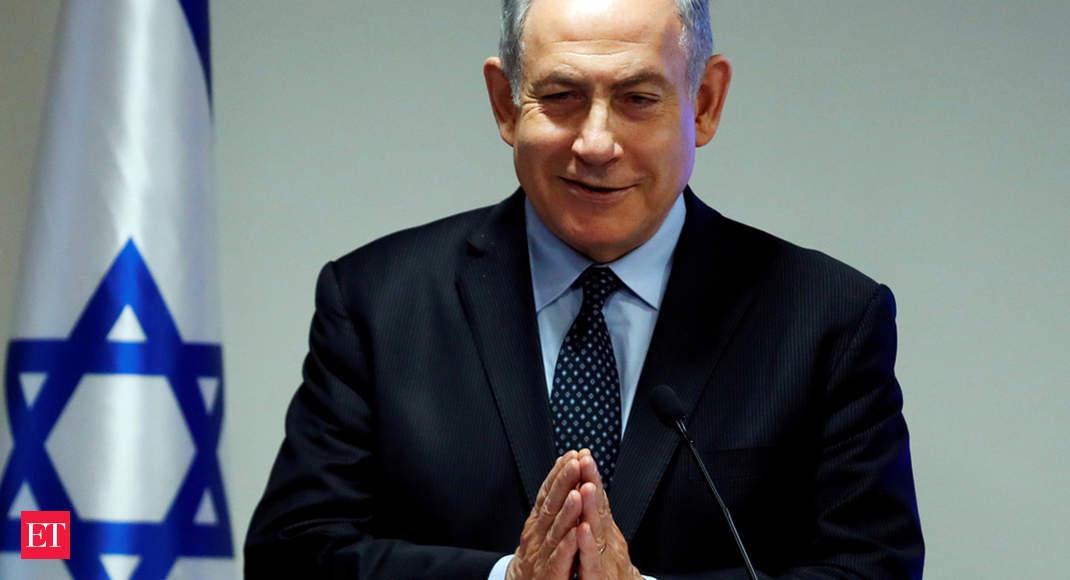 Image Israeli PM Netanyahu greets