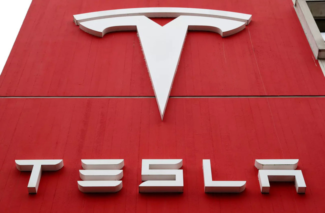 Tesla shares fall as profit and vehicle delivery forecast disappoint Wall Street