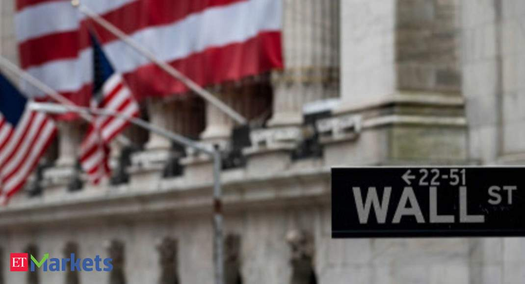 Nasdaq hits correction, Dow advances as stimulus bill nears finish line - Economic Times