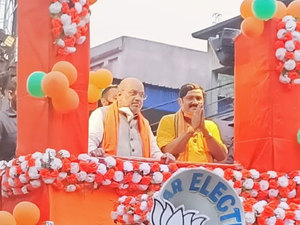 WB Polls 2021: Amit Shah holds massive roadshow in Habra, social distancing norms disappear