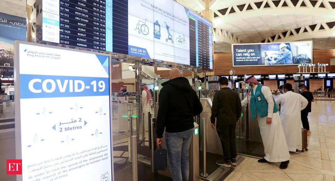 Image Saudis head to Bahrain as virus travel curbs eased