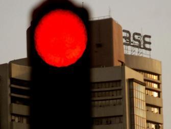 Sensex retreats from record high to close flat, Nifty ends at 16,635; Bajaj Finserv tanks 3%