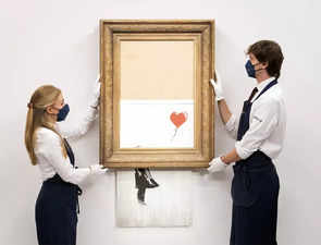 Banksy's 'Girl With Balloon' that self-shredded at auction to go under the hammer again, may fetch $5 mn