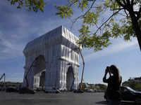 'A crazy dream come true': Arc de Triomphe wrapped in recyclable plastic unvelied