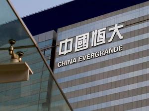 Evergrande agrees deal to avoid default on key bond: Company   Evergrande