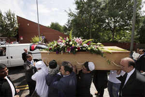 Mourners carry the coffin of Indian painter Maqbool Fida Husain during his funeral procession in south London, Friday, June 10, 2011. AP