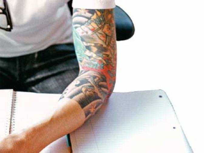 India ink tattoos in office the economic times for Indian ink tattoo