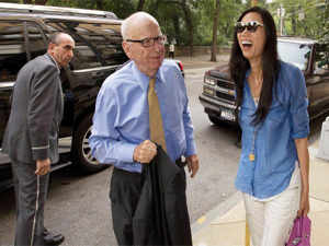 News Corporation Chairman and CEO Rupert Murdoch arrives with his wife Deng in New York