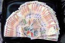 Rupee hits near 3 year high on weak dollar and US debt fears, exports to gain
