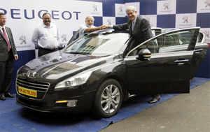 PSA Peugeot Citroen will bring hybrid cars to India: Philippe Varin ...