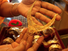 Gold demand swings to discount as price jump hurts demand