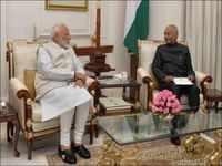 PM Modi meets President Kovind, tenders resignation