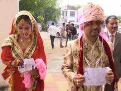 J-K: Newly married couple turn up for voting in Udhampur