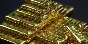 Gold edges up as US dollar trades below 1 year highs