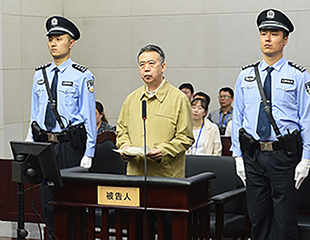 China's former Interpol chief sentenced to 13 years in prison