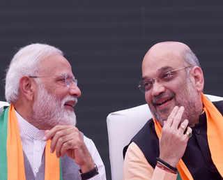 0b0f3d3af ETMarkets Morning Podcast: Team Modi roars back to power; RCap to ...