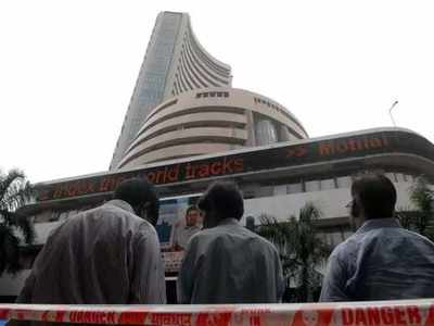Sensex falls 21 pts, Nifty holds 10,400 in volatile trade