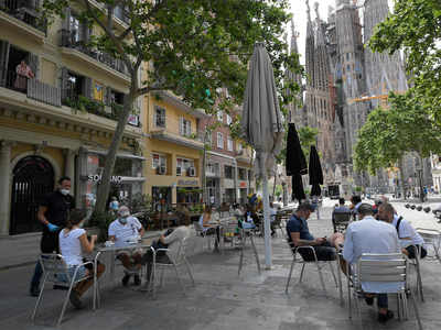 Parks packed, terraces open as Madrid and Barcelona ease curbs