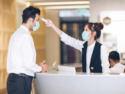 Are temperature checks enough to keep offices safe? Doctors say hand-washing & social distancing are equally important