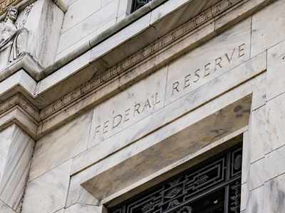 Fed revisits idea of pledging to keep interest rates low