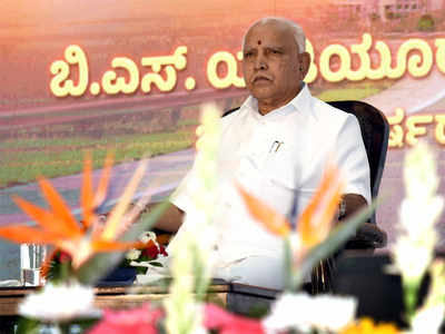 Yediyurappa caves in to pressure, shuffles ministry twice in a day